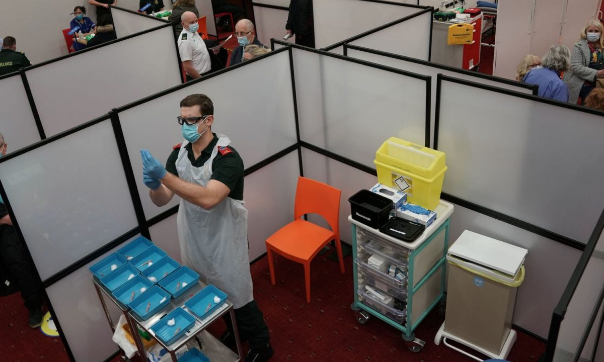 A healthcare workers fills a syringe with a Covid-19 vaccine at the NHS vaccine centre that has been set up at the Centre for Life in Times Square, Newcastle. The centre is one of the seven mass vaccination centres now opened to the general public as the government continues to ramp up the vaccination programme against Covid-19.