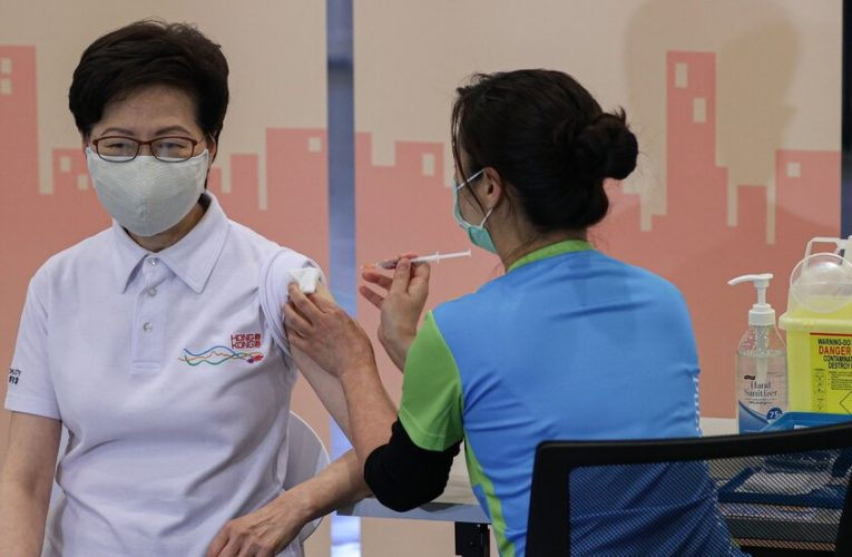 Hong Kong's top leader is inoculated ahead of a mass vaccination campaign.