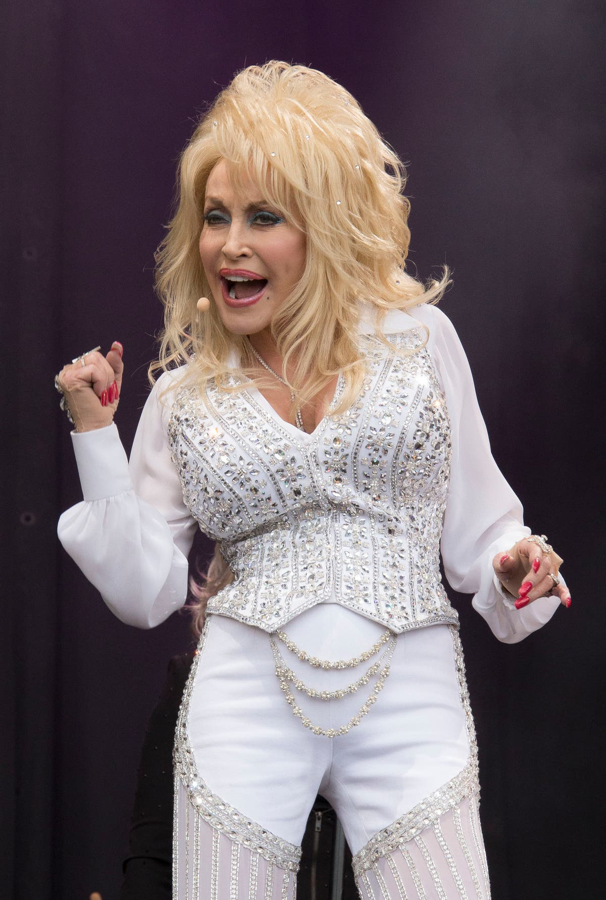 Dolly Parton - who helped fund vaccine - gets Covid shot in the arm