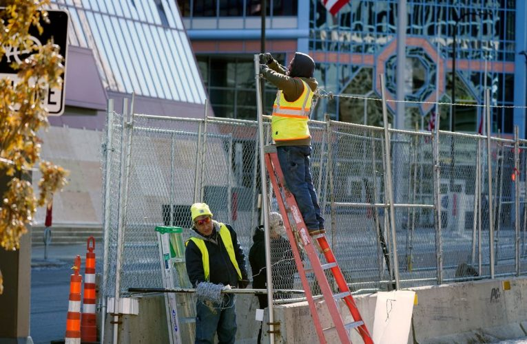 Minneapolis fortifies city hall with barbed wire and fencing ahead of George Floyd murder trial