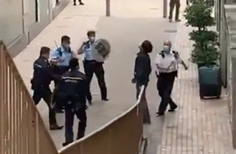 Video shows five officers beating a cornered Hong Kong protester
